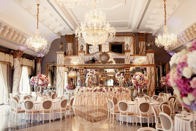 Luxurious dinner hall arranged for rich wedding party
